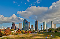 Houston Fall Skyline - We captured this skyline of the city of Houston with the reds and orange colors of fall in the trees along the bayou with  a beautiful blue sky on this pleasant fall day in a downtown park.  People were out doing all kinds of exercising from riding bikes to walking on the trails along the bayou to playing a game of soccer or volley ball and just enjoying the view.  Houston has an impressive skyline with some of the tallest skyscapers in the south United States.