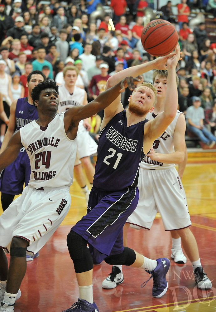 NWA Democrat-Gazette/MICHAEL WOODS &bull; @NWAMICHAELW<br /> Springdale's Towayne Bobo (24) and Fayetteville's Drake Wymer (21) fight for a rebound Friday, January 15, 2016 during their game at Springdale High School.