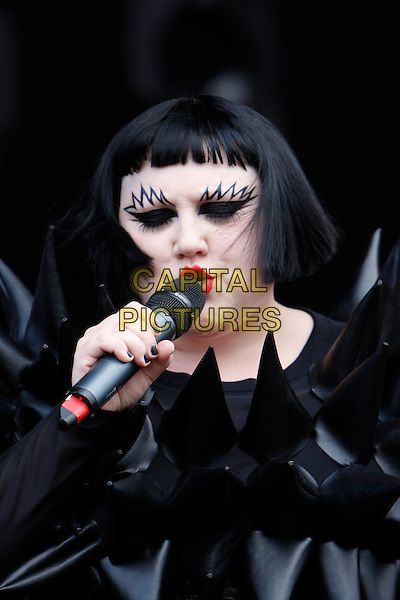 BETH DITTO of GOSSIP .Performing live at Wireless Festival in Hyde Park, London, England, UK, .July 2nd 2010..concert music gig live on stage portrait headshot black rubber spiky top spikes make-up eyebrows microphone singing costume outfit top dress eyeliner fringe bob .CAP/MAR.© Martin Harris/Capital Pictures.