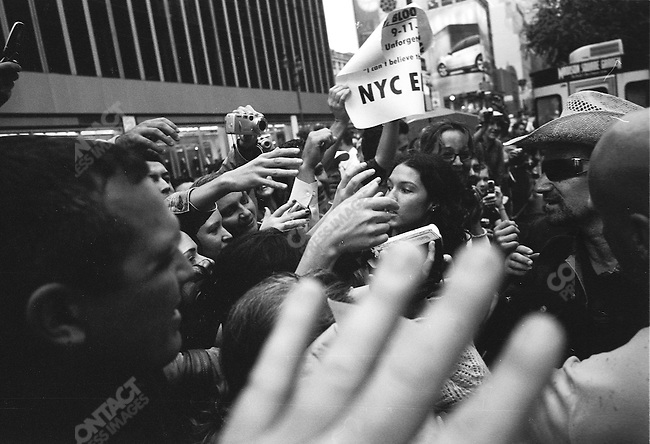 Bono, lead singer of U2 and social activist, meets fans outside of Madison Square Garden. New York City, October 2005.