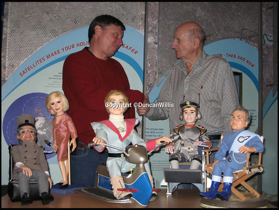 BNPS.co.uk (01202 558833)<br /> Pic: DuncanWillis/BNPS<br /> <br /> Duncan Willis with Gerry Anderson the creator of Thunderbirds.<br /> <br /> A Thunderbirds fanatic who always dreamt of owning an original Parker puppet now earns a living making them for fellow fans.<br /> <br /> Duncan Willis, 59, made his first puppet 15 years ago and his hobby has grown into a business where he creates puppets of the show's best-loved characters including Parker, Lady Penelope and Jeff Tracy. <br /> <br /> Mr Willis makes and sells about 20 Thunderbirds puppets a year at his home in Whiteley, Hampshire, together with elaborate props for them because he doesn't want them to be stood 'with a rod up their backside'. <br /> <br /> The puppets, which measure between 19 and 23in, take him four to six weeks to craft and cost in the region of £900.