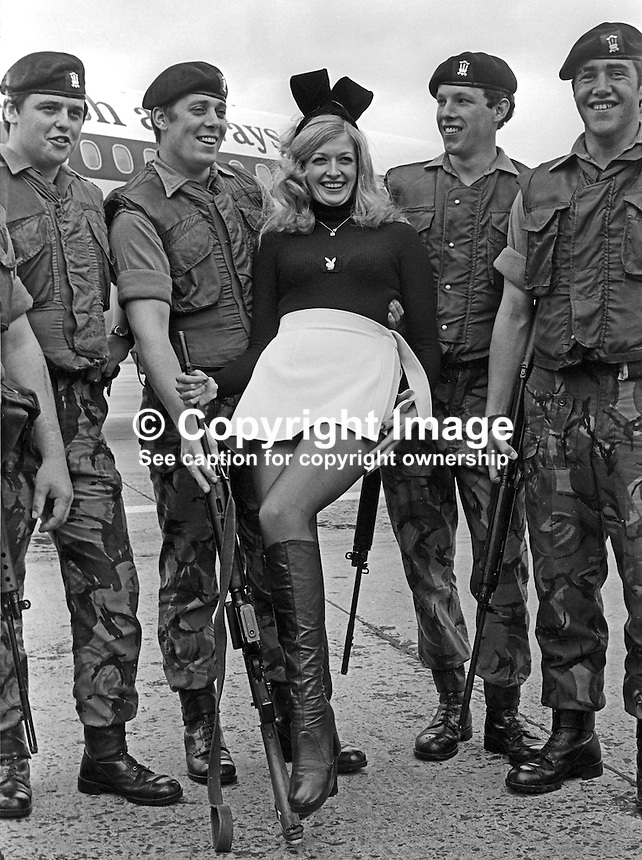 Bunny girl Theresa Lewis, 22 years, from the London Playboy Club, is welcomed by soldiers from the Royal Regiment of Wales currently serving in N Ireland. Theresa is the regimental pin-up and she paid a flying visit to them on 5th July 1974. 197407050379a..Copyright Image from Victor Patterson, 54 Dorchester Park, Belfast, United Kingdom, UK...For my Terms and Conditions of Use go to http://www.victorpatterson.com/Victor_Patterson/Terms_%26_Conditions.html