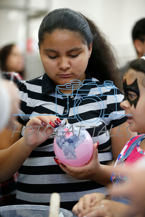Abigail Anguiano, 13, creates a paper m&acirc;ch&eacute; ornament during the La Posada Celebration at Western Nevada College, in Carson City, Nev., on Saturday, Dec. 15, 2018. <br /> Photo by Cathleen Allison/Nevada Momentum