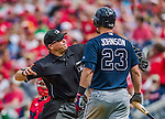 22 June 2014: MLB Umpire Mark Carlson ejects Atlanta Braves third baseman Chris Johnson in the 6th inning against the Washington Nationals at Nationals Park in Washington, DC. Johnson struck on a check swing verified by first base umpire Tim Welke, upsetting Johnson. The Nationals defeated the Braves 4-1 to split their 4-game series and take sole possession of first place in the NL East. Mandatory Credit: Ed Wolfstein Photo *** RAW (NEF) Image File Available ***
