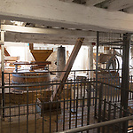 Historic milling machinery working inside Tide Mill, Woodbridge, Suffolk, England, UK