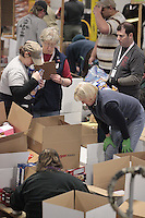 "Friday, February 15, 2013.   Volunteers sort and pack an assortment of ""people food"" to be sent out to the 22 checkpoints along the Iditarod trail at Airland Transport in Anchorage."