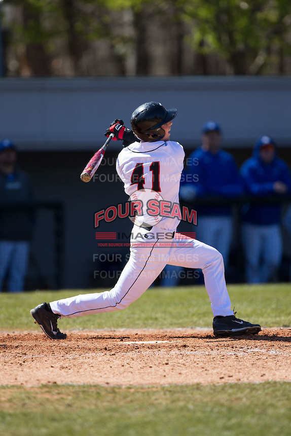 Will Robertson (41) of the Davidson Wildcats follows through on his swing against the Saint Louis Billikens at Wilson Field on March 28, 2015 in Davidson, North Carolina. (Brian Westerholt/Four Seam Images)