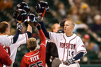 Houston's Bryan Pounds (14) knocks helmets with his teammates following his solo home run in the second inning versus Arizona State at the 2007 Houston College Classic at Minute Maid Park in Houston, TX, Sunday, February 11, 2007.  The Sun Devils  defeated the Cougars 11-1.