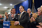 Albertson, New York, U.S. 26th October 2013. New York Governor ANDREW CUOMO, at podium, endorses TOM SUOZZI, left of him, for Nassau County Executive, at the Albertson Veterans of Foreign Wars VFW Post. Democrat Suozzi, the former Nassau County Executive, and Republican incumbent Mangano face each other in a rematch in the upcoming November 5th election.