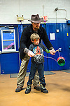 "Torrington, CT- 01 December 2016-123116CM05-  Matt Zordan and his son, Parker, 6, of Colebrook, play with a diabolo during a ""Last Night"" New Year's eve celebration at the Armory Torrington on Saturday.  The family event put on by the Torrington Parks and Recreation Department featured dancing performances, music by DJ Patti Adkins, games, craft stations, a Mad Science experiment station, face painting, and photo booth.   Christopher Massa Republican-American"