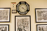 A clock that stopped at 10:22am on September 15, 1963 sits on a wall in 16th Street Baptist Church's basement amongst historic photos. In 1963, four girls were killed when a bomb under the church's side steps went off.