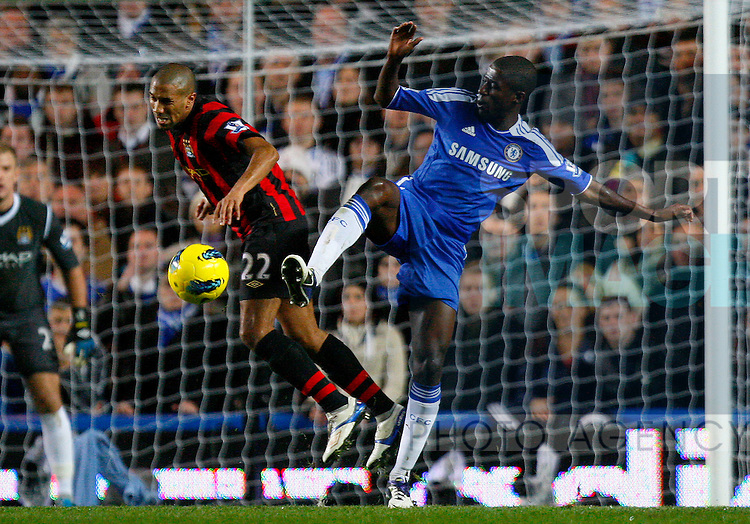 Gael Clichy of Manchester City and Ramires of Chelsea fight for the ball during the Premier League match between Chelsea and Manchester City at Stamford Bridge, London, England, on December 12, 2011