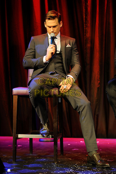 Lee Ryan<br /> Blue performing at the launch of their new single 'You Break My Heart', The Matcham Room, Hippodrome Casino, Leicester Square, London, England. <br /> 15th August 2013<br /> on stage in concert live gig performance performing music full length grey gray black suit singing sitting waistcoat    <br /> CAP/MAR<br /> &copy; Martin Harris/Capital Pictures