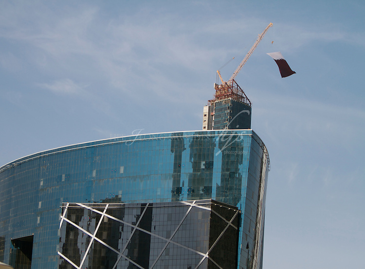 Qatar National Flag hanging on top of the building being built in West Bay, Doha, Qatar | Dec 10