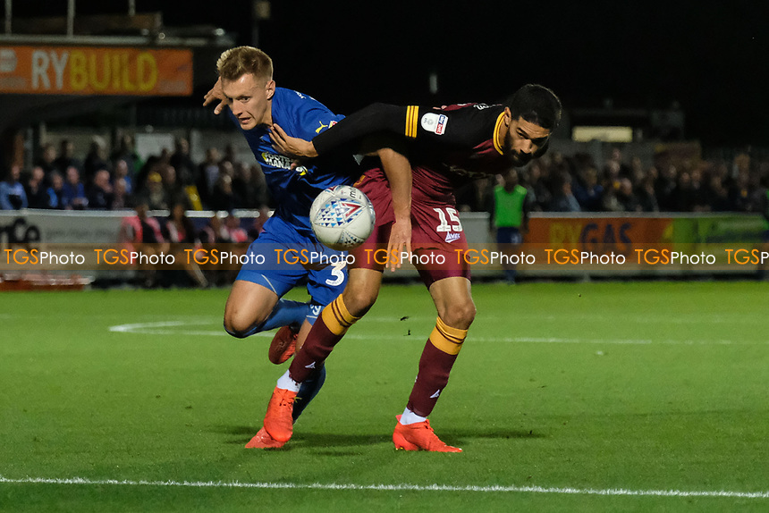 Joe Pigott of AFC Wimbledon and Kelvin Mellor of Bradford City during AFC Wimbledon vs Bradford City, Sky Bet EFL League 1 Football at the Cherry Red Records Stadium on 2nd October 2018