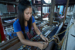 Lal Cross Par weaves cloth on a traditional loom in Kalay, a town in Myanmar.