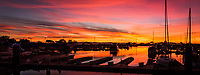 A multi-image panoramic of sunset at the San Leandro Marina with the blazing light in the sky reflected in the marina's water.