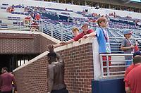 NWA Democrat-Gazette/CHARLIE KAIJO Young fans greet Arkansas Razorbacks players during practice before a football game, Saturday, September 7, 2019 at Vaught-Hemingway Stadium in Oxford, Miss.