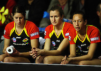 Magic benchwarmers Jessica Tuki, Nicola Pettit and Elias Shadrock watch as the Thunderbirds build on their lead during the ANZ Netball Championship match between the Waikato Bay of Plenty Magic and Adelaide Thunderbirds, Mystery Creek Events Centre, Hamilton, New Zealand on Sunday 19 July 2009. Photo: Dave Lintott / lintottphoto.co.nz