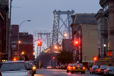 THIS IMAGE IS AVAILABLE EXCLUSIVELY FROM CORBIS.....Please search for image # 42-19897737 on www.corbis.com ....Williamsburg Bridge at dusk, viewed from a street in the Williamsburg neighborhood of Brooklyn, New York City.