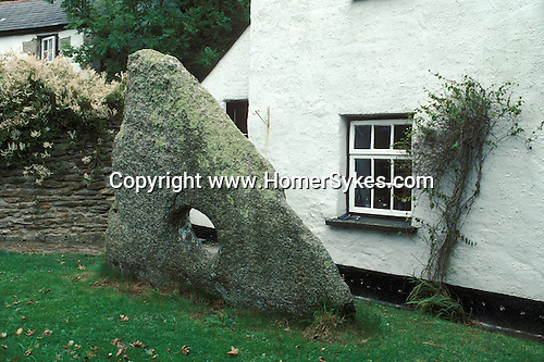 Tolven Holed Stone, in a back garden  Gweek, Cornwall, England
