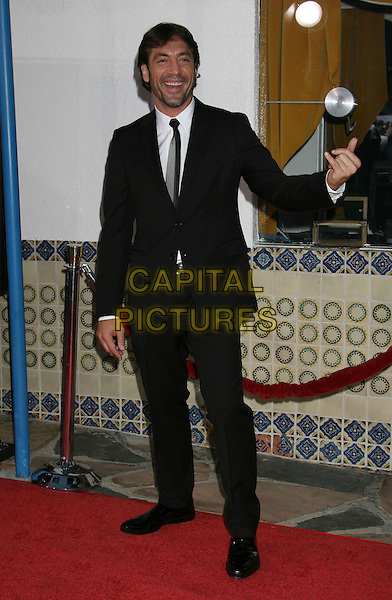 "JAVIER BARDEM .""Vicky Cristina Barcelona"" Los Angeles Premiere held at the Mann Village Theatre, Westwood, California, USA, .04 August 2008..full length black suit tie hand waving .CAP/ADM/MJ.©Michael Jade/Admedia/Capital Pictures"