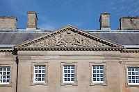 The Dumfries coat of arms resting on a nest of thistles ornaments the pediment of the entrance front