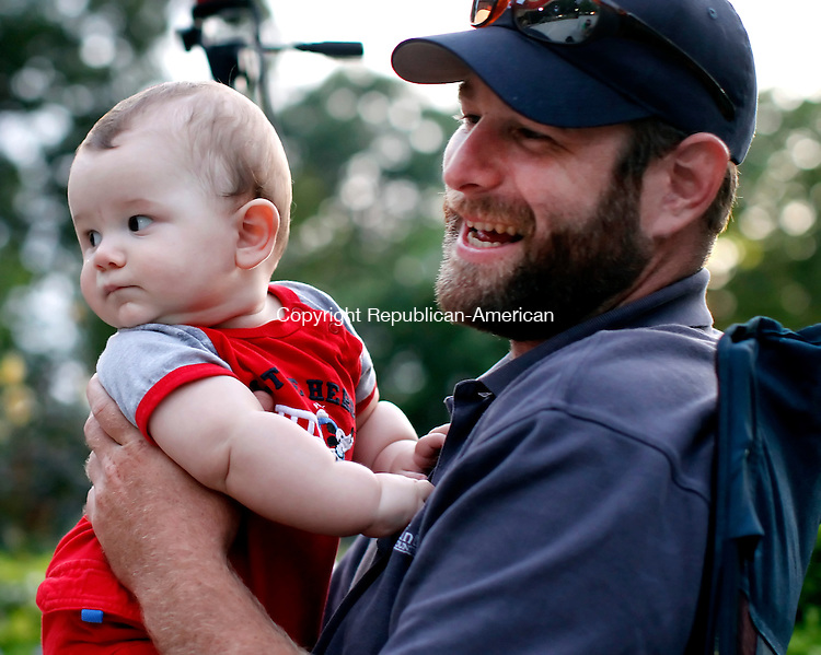 Torrington, CT- 26, July 2011-072611CM07  Tim Dinda and his son Logan, 8 months of Litchfield, listen to the sounds of Mad River Crossing at Coe Memorial Park Thursday night in Torrington.  The concert was part of the Torrington Parks and Recreation Department summer concert series.    Christopher Massa Republican-American