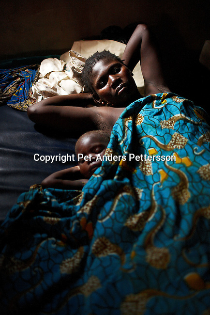 DUBIE, DEMOCRATIC REPUBLIC OF CONGO DECEMBER 11: A mother lies next to her sick child on December 11, 2005 in Dubie Hospital, in Dubie, Katanga Province in Congo, DRC. Doctors Without Borders (MSF) provides health care to residents of Dubie and arriving refugees. Thousands of refugees have fled fighting between the Congolese army and Mai-Mai rebels in Eastern Congo. The refugees also received blankets, plastic sheeting, cooking utensils and a food ration from them. MSF is one of the few organizations that work in Katanga Province. These refugees are some of the victims of the civil war that started in 1996. Many people have moved from area to area the last years trying to find safety. About four million people have died in Congo since 1996, making it the deadliest humanitarian crisis in recent memory. Most of people have died of preventable diseases such as malaria, measles, diarrhea, respiratory infections and malnutrition. The health system has collapsed and very few people have access to healthcare. Congo is planning to hold general elections by June 2006, the first democratic elections in forty years..(Photo by Per-Anders Pettersson/Getty Images)..