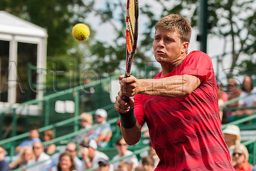 13.04.2012. Houston Texas.  Ryan Harrison returns a ball against Michael Russell during a quarterfinal match of the US Men's Clay Court Championship at the River Oaks Country Club in Houston, TX.  Russell defeated Harrison 6-5-6.