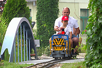 Participants enjoy a ride on a small scale train during the XII. European Garden Railway Convention held in Hungarian Railway Museum in Budapest, Hungary on June 16, 2019. ATTILA VOLGYI