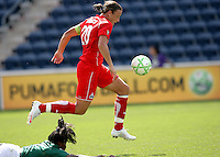 Washington Freedom forward Abby Wambach (20) outplays fallen Chicago Red Star defender Ifeoma Dieke (4) for the ball en route to scoring the Washington Freedom's first goal.  The Washington Freedom defeated the Chicago Red Stars 3-2 at Toyota Park in Bridgeview, IL on July 26, 2009.