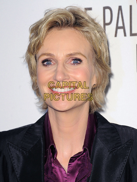JANE LYNCH .at The PaleyFest 2011 Panel for Glee held at The Saban Theater in Beverly Hills, California, USA, March 16th,2011..portrait headshot purple shirt blouse  black jacket  make-up smiling beauty                                                         .CAP/RKE/DVS.©DVS/RockinExposures/Capital Pictures.