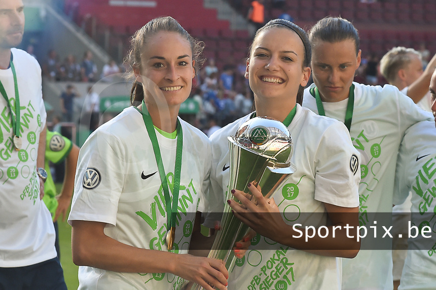 20170527 - KOELN , GERMANY : Wolfsburg's Tessa Wullaert (L) and team mate  pictured after the final of German Women's Cup 2017 - Pokal Final Frauen , a soccer women game between SC Sand and holders VfL Wolfsburg  , at the Rhein Energie Stadion , saturday 27 th Mayl 2017 . PHOTO SPORTPIX.BE | DIRK VUYLSTEKE