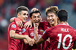 Shanghai FC Midfielder Akhmedov Odil (C) celebrating his score with his teammates Oscar Emboaba Junior (L) and Fu Huan (R) during the AFC Champions League 2017 Round of 16 match between Shanghai SIPG FC (CHN) vs Jiangsu FC (CHN) at the Shanghai Stadium on 24 May 2017 in Shanghai, China. Photo by Marcio Rodrigo Machado / Power Sport Images