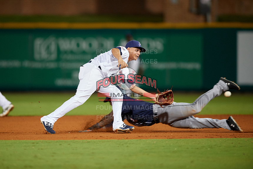 Pensacola Blue Wahoos Shrimp shortstop Luis Gonzalez (19) waits to receive a throw as Anfernee Seymour (2) slides into second base during a game against the Jacksonville Jumbo on August 15, 2018 at Blue Wahoos Stadium in Pensacola, Florida.  Jacksonville defeated Pensacola 9-2.  (Mike Janes/Four Seam Images)