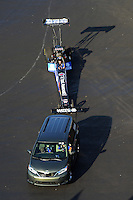 Apr. 13, 2012; Concord, NC, USA: The car of NHRA top fuel dragster driver Antron Brown is towed from the pits during qualifying for the Four Wide Nationals at zMax Dragway. Mandatory Credit: Mark J. Rebilas-