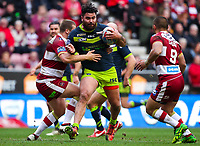 Picture by Alex Whitehead/SWpix.com - 11/03/2018 - Rugby League - Betfred Super League - Wigan Warriors v Wakefield Trinity - DW Stadium, Wigan, England - Wakefield's David Fifita is tackled by Wigan's Tony Clubb.