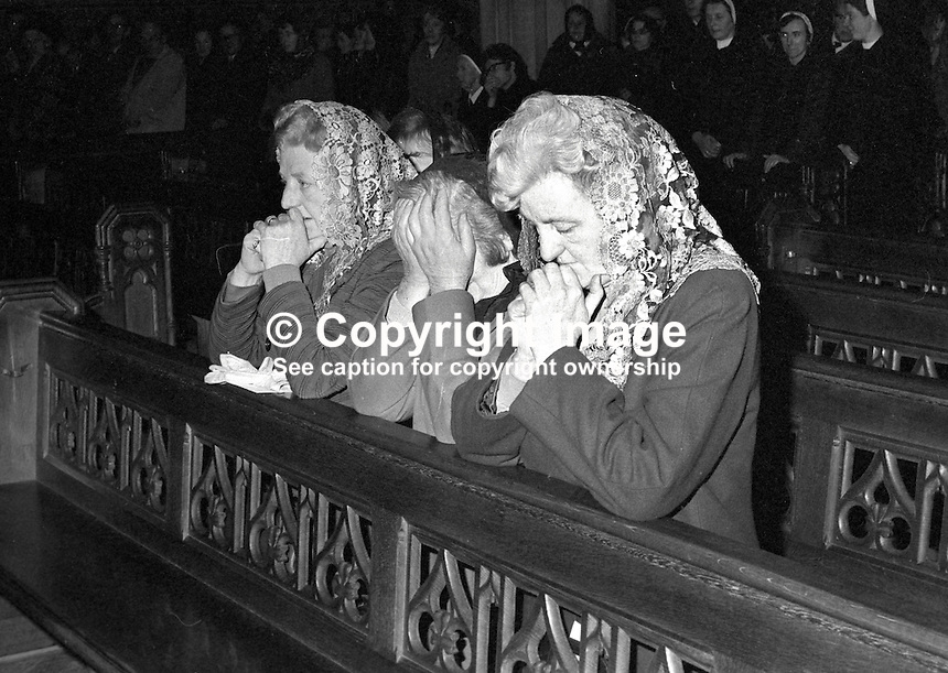 Funeral of Cardinal William Conway,  Archbishop of Armagh, Primate of All Ireland - The cardinals mother and two sisters pray during the Requiem Mass at St Patrick's Cathedral, Armagh. The cardinal died 17th April 1977. 197704190054a.   <br />