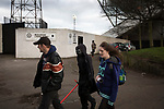 Three people making their way from a nearby sci-fi convention past the player's entrance at Meadowbank Stadium before Edinburgh City hosted Montrose in their SPFL League 2 match. City were looking for points in their bid to avoid relegation in their first season in League 2 after promotion from the Lowland League in 2015-16. The match ended 1-1, Josh Walker scoring for City, with Montrose equalising in the last minute, watched by a crowd of 346.
