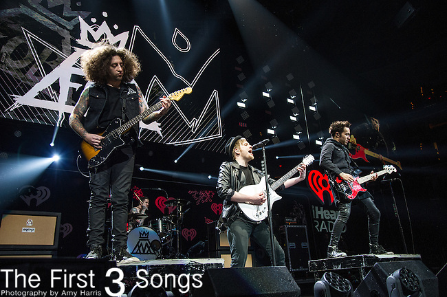 Pete Wentz, Patrick Stump, Andy Hurley and John Trohman of Fall Out Boy perform onstage during Hot 99.5's Jingle Ball 2013 presented by Overstock.com, at the Verizon Center on December 17, 2013 in Washington, D.C.