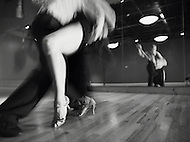 A couple does the Tango in dance studio