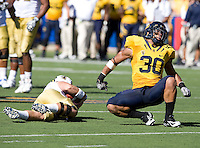 Mychal Kendricks of California celebrates after sacking UCLA quarterback Kevin Prince during the game at Memorial Stadium in Berkeley, California on October 9th, 2010.   California defeated UCLA, 35-7.