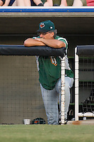 Augusta GreenJackets pitching coach Ross Grimsley (25) watches the action from the top step of the visitors dugout at Fieldcrest Cannon Stadium in Kannapolis, NC, Friday August 22, 2008. (Photo by Brian Westerholt / Four Seam Images)
