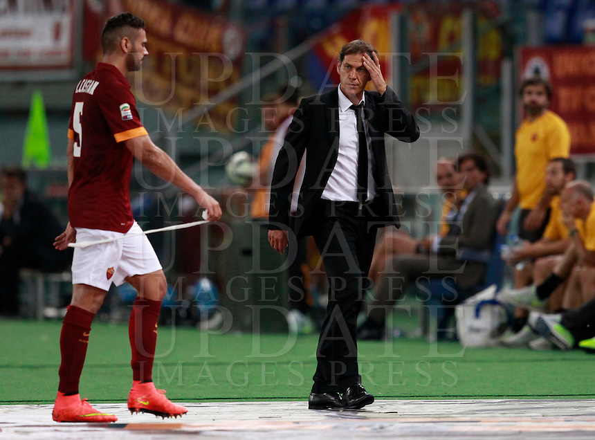 Calcio, amichevole Roma vs Fenerbahce. Roma, stadio Olimpico, 19 agosto 2014.<br /> Roma defender Leandro Castan, of Brazil, left, leaves the pitch after being injured, past coach Rudi Garcia, of France, during the friendly match between AS Roma and Fenerbahce at Rome's Olympic stadium, 19 August 2014.<br /> UPDATE IMAGES PRESS/Isabella Bonotto