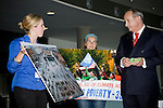May Boeve (left) from 350.org presents a photograph to Yvo de Boer, executive secretary of the UNFCCC at the Barcelona Climate Talks. The photograph was taken in Copenhagen during the international day of climate action on Oct. 24, 2009.  (©Robert vanWaarden ALL RIGHTS RESERVED)