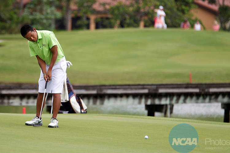 17 MAY 2013:  Dakun Chang of Methodist University watches his putt during the Division III Men's Golf Championship held at the Sandestin Golf and Beach Resort Raven Course in Destin, FL.  Jones shot a -3 to win the national title.  Mark Wallheiser/NCAA Photos