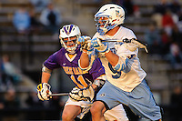 Baltimore, MD - April 5: Midfielder John Greeley #9 of the John Hopkins Blue Jays drives at the cage during the Albany v Johns Hopkins mens lacrosse game at  Homewood Field on April 5, 2012 in Baltimore, MD. (Ryan Lasek/Eclipse Sportwire)
