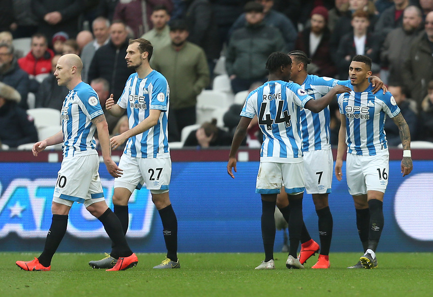 Huddersfield Town's Karlan Grant (far right) is congratulated after scoring his side's second goal<br /> <br /> Photographer Rob Newell/CameraSport<br /> <br /> The Premier League - West Ham United v Huddersfield Town - Saturday 16th March 2019 - London Stadium - London<br /> <br /> World Copyright © 2019 CameraSport. All rights reserved. 43 Linden Ave. Countesthorpe. Leicester. England. LE8 5PG - Tel: +44 (0) 116 277 4147 - admin@camerasport.com - www.camerasport.com