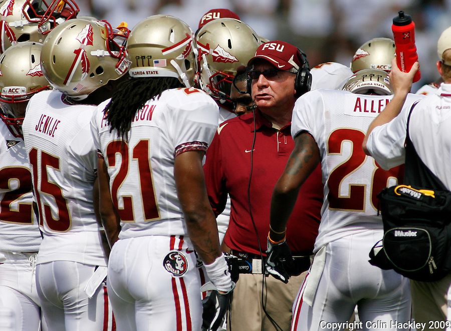 TALLAHASSEE, FL 9/26/09-FSU-USF FB09 CH26-Florida State's Defensive Coordinator Mickey Andrews rallies his troops against South Florida's during first half action Saturday at Doak Campbell Stadium in Tallahassee. ..COLIN HACKLEY PHOTO